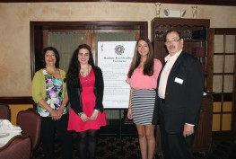 President Nancy Knight ans Scholarship Committee Co-chair d Nicholas Wunner pose with 2015 Scholarship recipients Natalia Pereria (left) and Victora Mobilio (right).