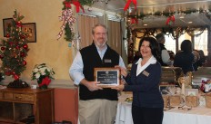 2015 President and 2012 Business Person of the Year recipient Nancy Knight presents Joe Eible with his award.