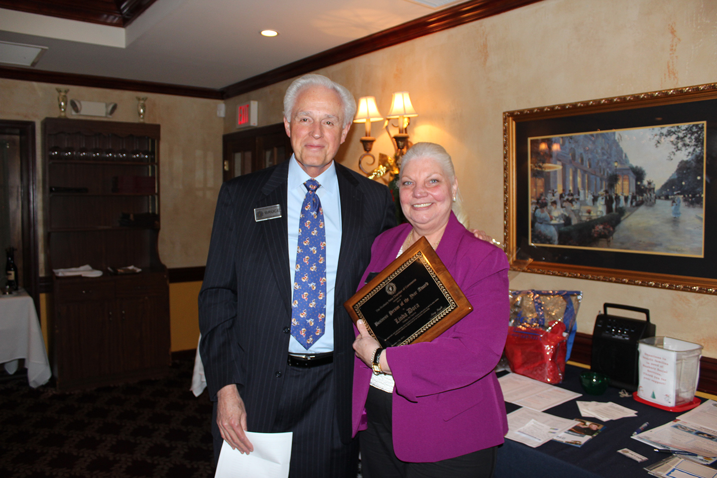 In the picture: 1991 Winner and board member Bruce Bristol presents the 2014 Business Person of the Year Award to Linda Dora.