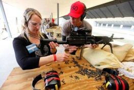 Pam Smith, of the Roxbury Chamber of Commerce, left, learns how to fire a M249 machine gun with the help of Range Safety Officer Emmanuel Marasigan during a combat training excursion at Picatinny Arsenal. Photo by Daniel Freel/New Jersey Herald