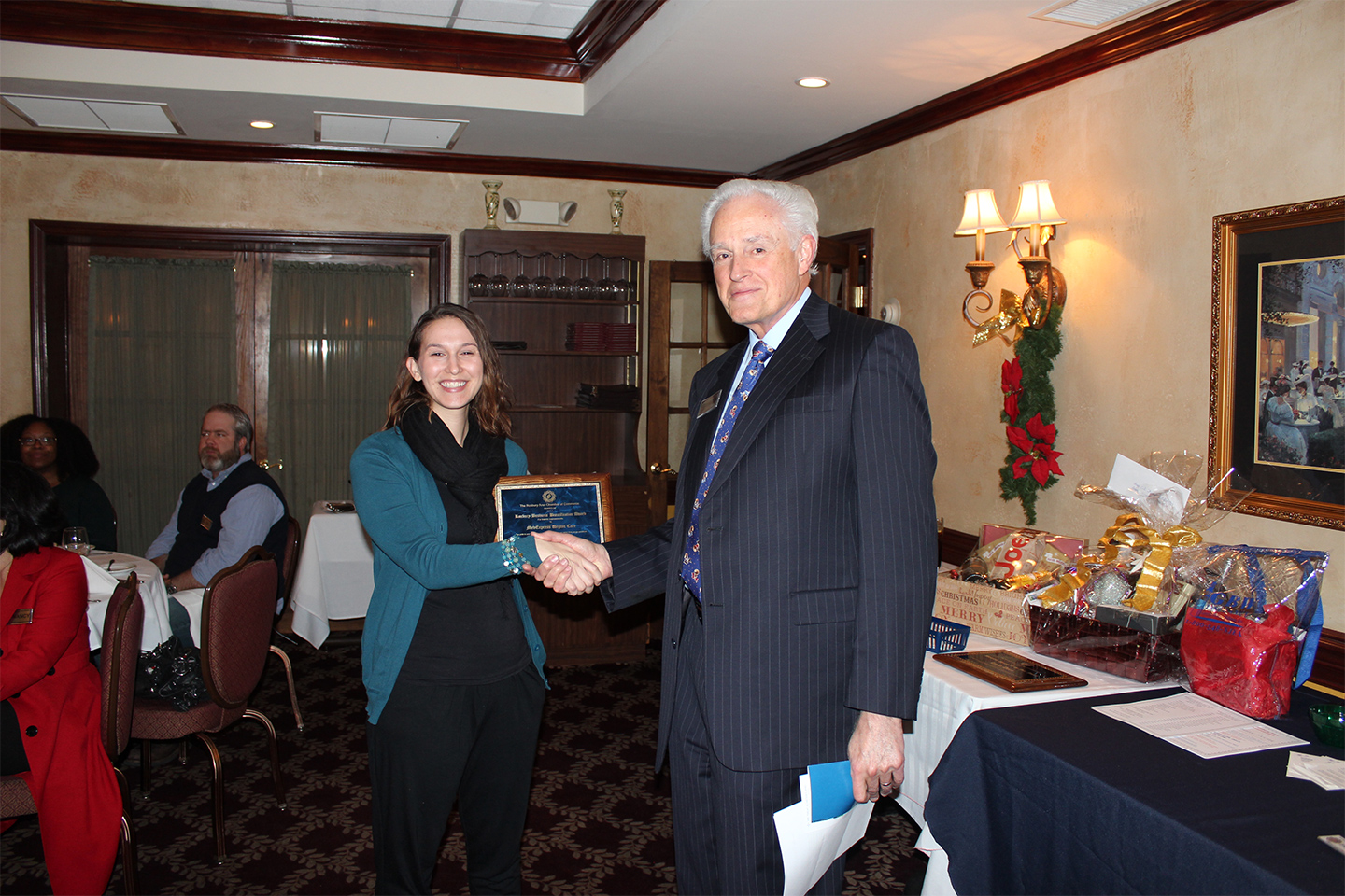 Regina Jewell, of MedExpress Urgent Care in Ledgewood, accepts the award for interior improvements.