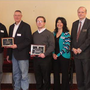 2013 Business Person of the Year, Brian Hewitt (center)
